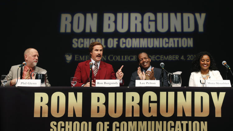 Actor and comedian Will Ferrell, who plays TV anchorman Ron Burgundy, stays in character as he speaks during a news conference at Emerson College in Boston, Wednesday, Dec. 4, 2013. The school has changed the name of its School of Communication for one day to honor the fictitious television anchorman. Also on the panel are, from left, Phil Glenn, Interim Dean of the School of Communication; Lee Pelton, President of Emerson College; and Muna Moushien, journalist at Emerson College. (AP Photo/Elise Amendola)