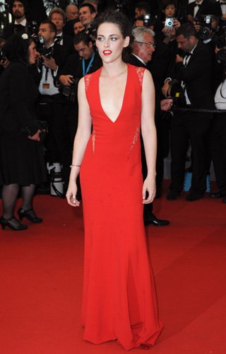 Who: Kristen Stewart What: Red Reem Acra gown Where: Cosmopolis premiere Why We Love It: As much as Stewart seems to be gritting her teeth on the red carpet, she's been consistently upping her fashion