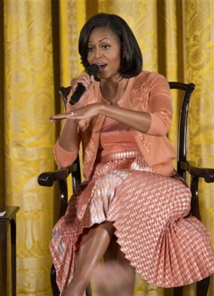 First lady Michelle Obama speaks to children in the East Room of the White House in Washington, Thursday, April 26, 2012, during a celebration of the