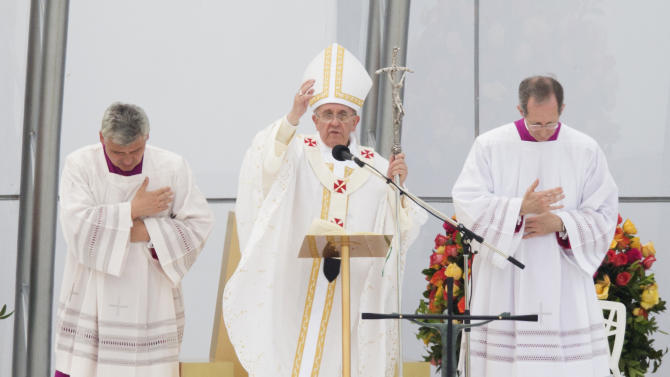 """Pope Francis celebrates Mass on Copacabana beach, in Rio de Janeiro, Brazil, Sunday, July 28, 2013. Francis wrapped up a historic trip to his home continent Sunday with a Mass on Copacabana beach, urging the young people on hand for World Youth Day's concluding Mass to go out and spread their faith """"to the fringes of society, even to those who seem farthest away, most indifferent."""" (AP Photo/Victor R. Caivano)"""