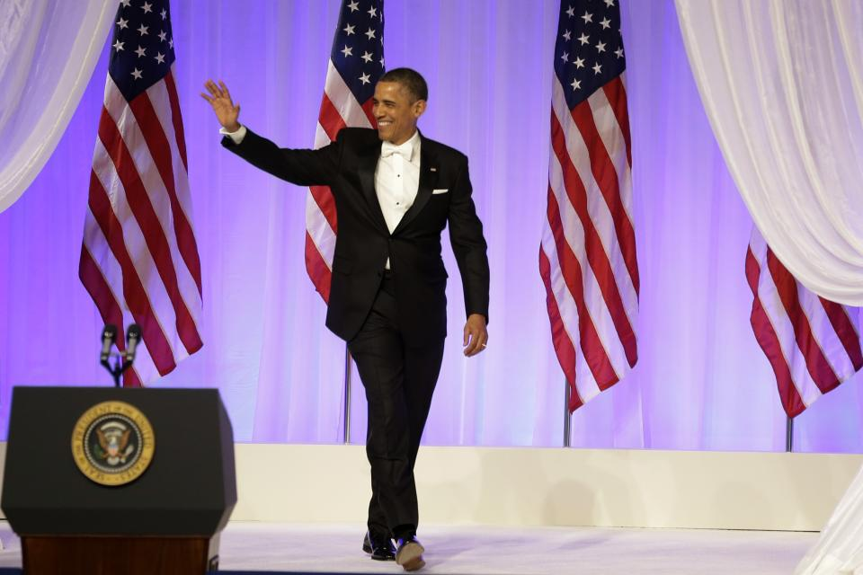 President Barack Obama arrives at the Commander-in-Chief's Inaugural Ball in Washington, at the Washington Convention Center during the 57th Presidential Inauguration on Monday, Jan. 21, 2013. (AP Photo/Jacquelyn Martin)