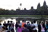 Tourists visit Cambodia's Angkor Wat temple last year. The number of international tourist arrivals grew by 4.0 percent to 1.035 billion in 2012, up from 996 million in 2011, the Madrid-based United Nations World Tourism Organisation said in an annual survey