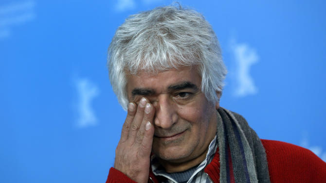 Co-director Kamboziya Partovi  gestures  during the photo call of the film Closed Curtain at the 63rd edition of the Berlinale, International Film Festival in Berlin, Germany, Tuesday, Feb. 12, 2013. (AP Photo/Michael Sohn)