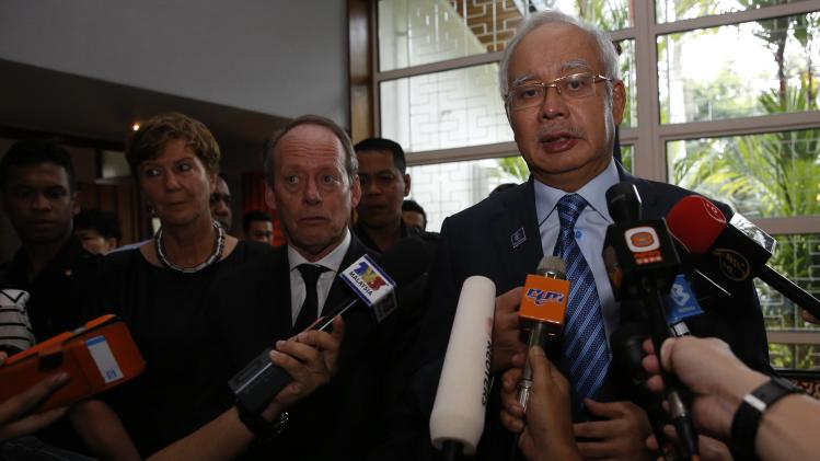 Malaysian Prime Minister Razak, with Dutch ambassador Molenaar, speaks to the press about the recovery of bodies killed when Malaysian Airlines MH17 was shot down over the Ukraine, at the residence of the Netherlands' ambassador in Kuala Lumpur