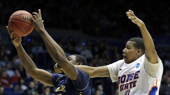 La Salle forward Jerrell Wright pulls a rebound away from Boise State forward Ryan Watkins (0) in the first half of a first-round game of the NCAA college basketball tournament, Wednesday, March 20, 2013, in Dayton, Ohio. (AP Photo/Al Behrman)