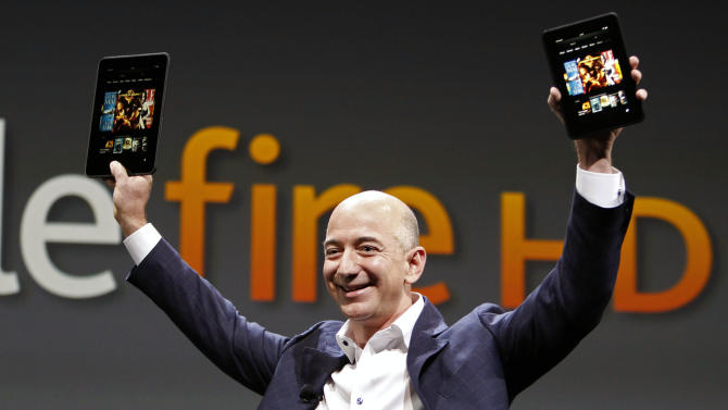 FILE - In this Sept. 6, 2012 file photo, Jeff Bezos, CEO and founder of Amazon, introduces the Amazon Kindle Fire during an event in Santa Monica, Calif. Amazon, the corporate juggernaut that started out with books and soon moved into music, video, cloud computing and Kindle e-readers, is hosting a launch event Wednesday, June 18, 2014 in Seattle, and media reports indicate the product will be an Amazon phone — perhaps one with multiple cameras that can produce 3-D photos. (AP Photo/Reed Saxon, File)