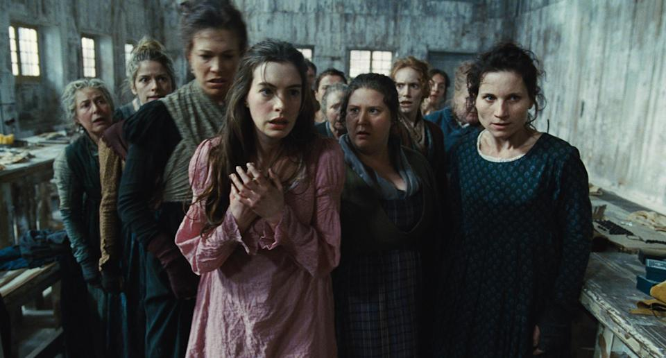 "This undated publicity photo provided by Universal Pictures shows Anne Hathaway, left, as Fantine, being thrown out of the factory in a scene from director, Tom Hooper's new film, ""Les Misérables,"" the motion-picture adaptation of the beloved global stage musical adapted from Victor Hugo's novel. (AP Photo/Universal Pictures)"