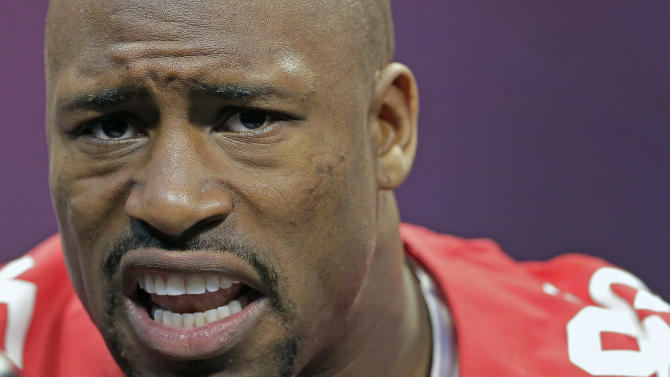 San Francisco 49ers tight end Vernon Davis answers reporters questions during media day for the NFL Super Bowl XLVII football game Tuesday, Jan. 29, 2013, in New Orleans. (AP Photo/Charlie Riedel)