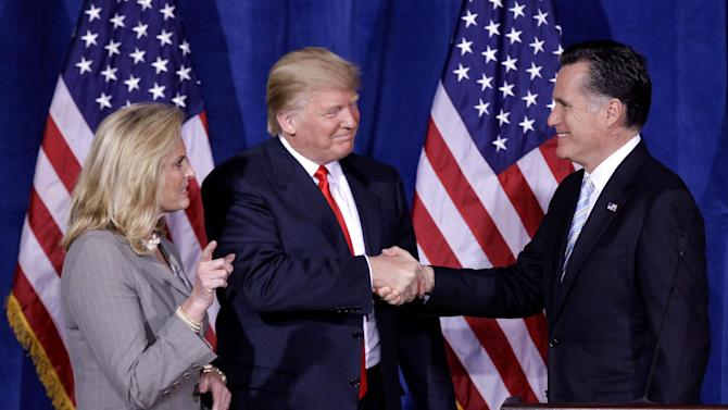 FILE - In this Thursday, Feb. 2, 2012 file photo, Donald Trump greets Republican presidential candidate, former Massachusetts Gov. Mitt Romney, after announcing his endorsement of Romney during a news conference in Las Vegas. President Barack Obama and Romney, have visited the state, competing strenuously for Nevada's six electoral votes in what has become one of the most intense swing-state contests. Romney's wife, Ann, is at left. (AP Photo/Julie Jacobson, File)