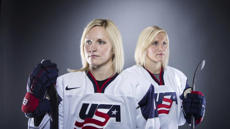 Olympic ice hockey players Jocelyne and Monique Lamoureux pose during the 2013 U.S. Olympic Team Media Summit in Park City, Utah