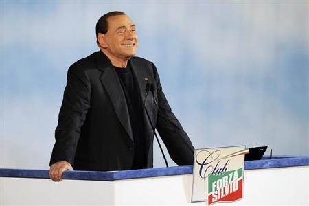 "Former Italian PM Berlusconi reacts as he attends a rally to launch the ""Forza Silvio"" club in downtown Rome"