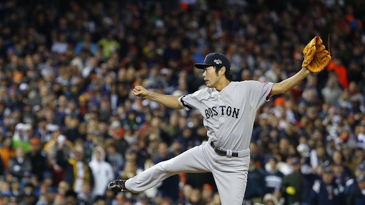 Boston Red Sox's Koji Uehara throws in the eighth inning during Game 5 of the American League baseball championship series against the Detroit Tigers, Thursday, Oct. 17, 2013, in Detroit. (AP Photo/Paul Sancya)