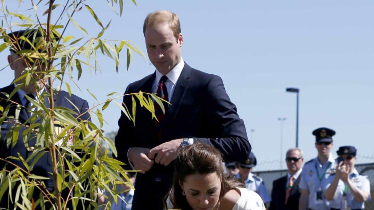 Britain's Catherine Duchess of Cambridge plants a tree at the RAAF Amberley airbase near Brisbane
