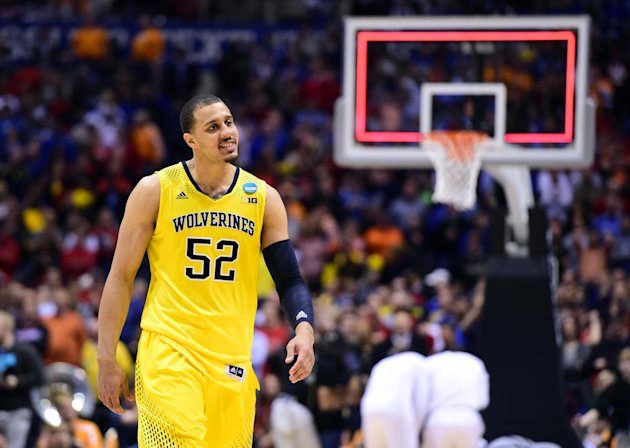 Michigan forward Jordan Morgan walks off the court after defeating Tennessee in the semifinals. (Bob Donnan/USA TODAY Sports)