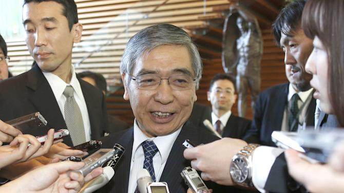 Newly appointed Bank of Japan Gov. Haruhiko Kuroda smiles as he speaks to reporters after meeting with Prime Minister Shinzo Abe at the prime minister's official residence in Tokyo Thursday, March 21, 2013. Kuroda, a finance ministry veteran and former president of the Asian Development Bank, reaffirmed his pledge to prioritize getting Japan's economy out of its long bout of deflation. (AP Photo/Kyodo News) JAPAN OUT, MANDATORY CREDIT, NO LICENSING IN CHINA, HONG KONG, JAPAN, SOUTH KOREA AND FRANCE