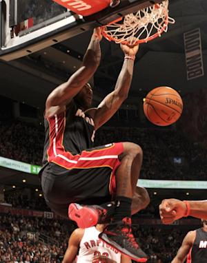 James scores 35 as Heat beat Raptors 104-95