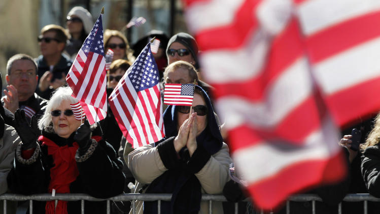 Spectators applaud as a parade to honor Iraq War veterans passes Saturday, Jan. 28, 2012, in St. Louis. Thousands turned out to watch the first big welcome home parade in the U.S. since the last troops left Iraq in December. (AP Photo/Jeff Roberson)