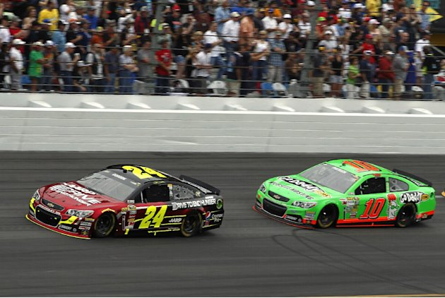 Jeff Gordon (24) and Danica Patrick (10) lead during early laps of the NASCAR Daytona 500 Sprint Cup Series auto race at Daytona International Speedway, Sunday, Feb. 24, 2013, in Daytona Beach, Fla. (