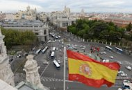 The Spanish flag flys at the Plaza de Cibeles in Madrid, on April 25. The interest rate on Spain&#39;s benchmark 10-year bonds soared above 6.0 percent on Wednesday, a borrowing rate widely believed to be unsustainable for the crisis-hit Spanish government