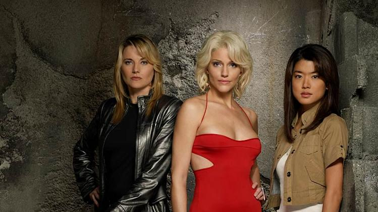 Lucy Lawless as D'Anna Biers , Tricia Helfer as Number Six and Grace Park as Sharon Valerii in Battlestar Galactica on the Sci Fi Channel.