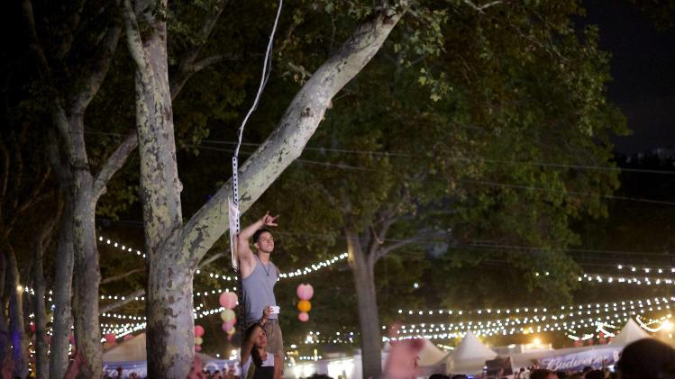 Revellers watch the Kanye West performance at the Made in America festival in Philadelphia