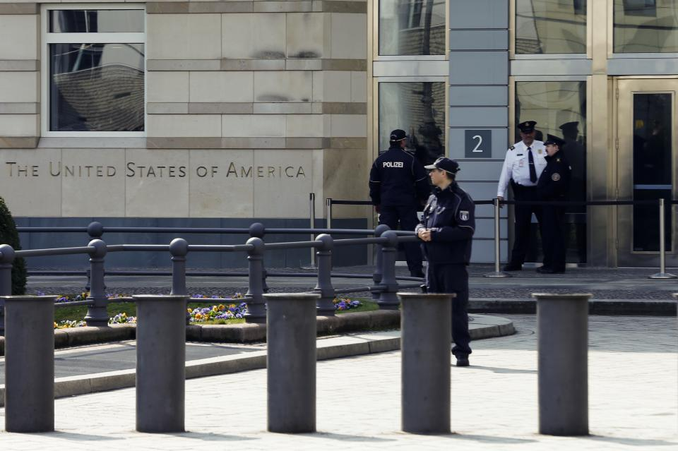 German and United States security officers patrol in front of the  U.S. embassy  in Berlin, Tuesday, April 16, 2013. On Monday April 15, 2013 two bombs exploded  in the crowded streets near the finish line of the Boston marathon.  (AP Photo/Markus Schreiber)