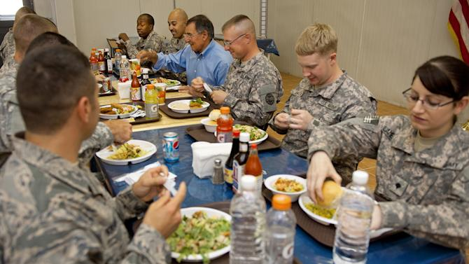 US Secretary of Defense Leon Panetta, 4th right,, has lunch with 10 junior enlisted soldiers during  his visit to Camp Victory in Baghdad, on Monday  July 11, 2011. (AP Photo/ Paul J. Richards, Pool)