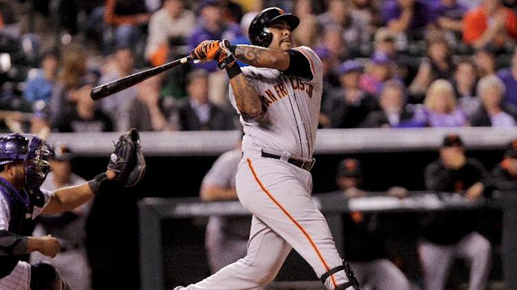 Sanchez's slam in 11th helps Giants beat Rox 12-10