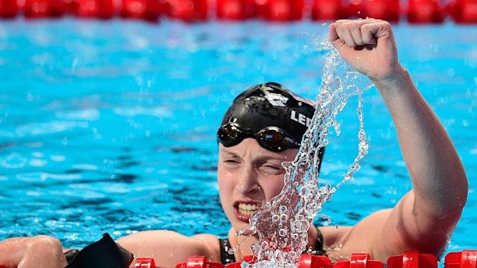US Katie Ledecky celebrates after setting a new world record and winning the final of the women's 1500m freestyle swimming event at the world championships in Kazan, on August 4, 2015