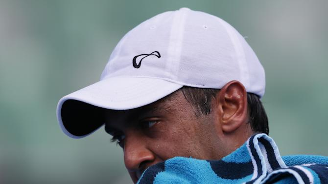 Rajeev Ram of the US wipes the sweat from his face during his second loss to Croatia's Marin Cilic at the Australian Open tennis championship in Melbourne, Australia, Thursday, Jan. 17, 2013. (AP Photo/Aaron Favila)