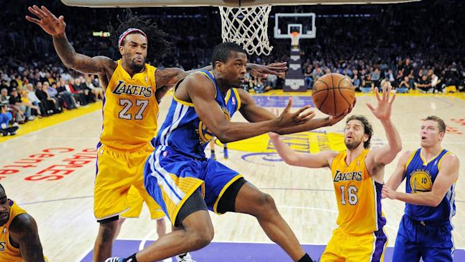 Golden State Warriors forward Harrison Barnes, second from left, goes up for a shot as Los Angeles Lakers center Jordan Hill, left, and forward Pau Gasol, second from right, of Spain, defend and Warriors forward David Lee watches during the first half of their NBA basketball game, Friday, Nov. 9, 2012, in Los Angeles. (AP Photo/Mark J. Terrill)