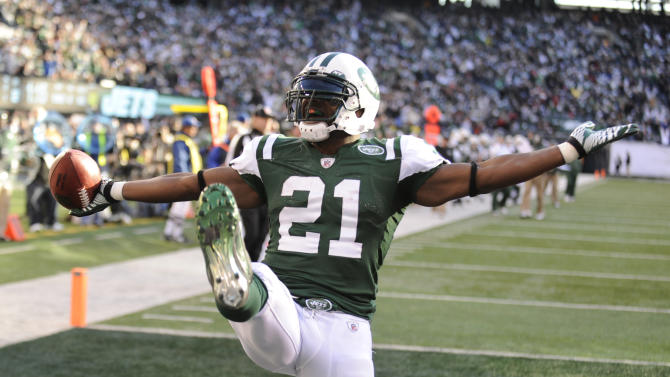 New York Jets' LaDainian Tomlinson celebrates his touchdown during the second quarter of an NFL football game against the Kansas City Chiefs on Sunday, Dec. 11, 2011, in East Rutherford, N.J. (AP Photo/Bill Kostroun)