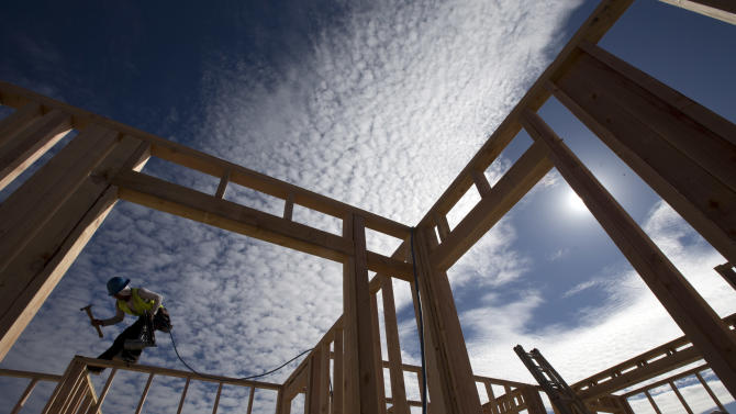 FOR USE AS DESIRED, YEAR END PHOTOS - FILE - In this Nov. 16, 2012 file photo, construction worker Elabert Salazar works on a house frame for a new home in Chula Vista, Calif.  In 2012, the unemployment rate dipped to a four-year-low of 7.7 percent, stock markets rose, builders broke ground on more homes, and November was the best sales month in nearly five years for U.S. automakers. (AP Photo/Gregory Bull, File)