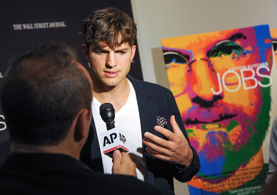 "Actor Ashton Kutcher is interviewed as he attends a special screening of ""JOBS"" hosted by The Wall Street Journal at the Museum of Modern Art on Wednesday, Aug. 7, 2013, in New York. (Photo by Evan Agostini/Invision/AP)"