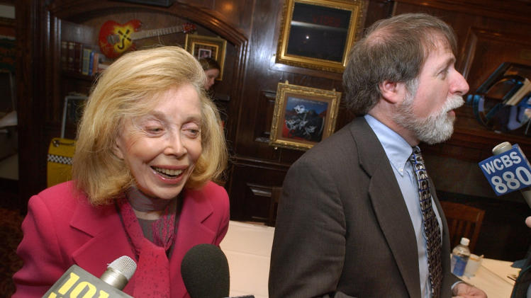 """FILE - In this Jan. 16, 2004 file photo, psychologist Dr. Joyce Brothers, left, and Bruce Spizer, author of """"The Beatles are Coming,"""" are interviewed at a news conference in New York. Brothers died Monday, May 13, 2013, in New York City, according to publicist Sanford Brokaw. She was 85. (AP Photo/Richard Drew, File)"""