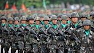 "Photo illustration of Philippine soldiers on parade in Manila. The Philippine military was rocked Sunday by a fresh ""torture"" video purporting to show troops abusing trainees as it moved to cleanse its ranks of rogue soldiers"