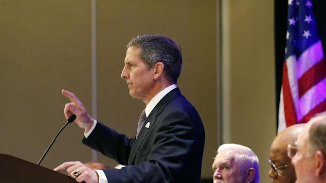 U.S. Veterans Administration Deputy Secretary Sloan Gibson speaks during the opening session of the National Order of the Purple Heart National Convention in Denver, Tuesday Aug. 5, 2014. Gibson says more employees will be disciplined as the department sorts out a scandal over long waits for health care and falsified data. (AP Photo/Brennan Linsley)
