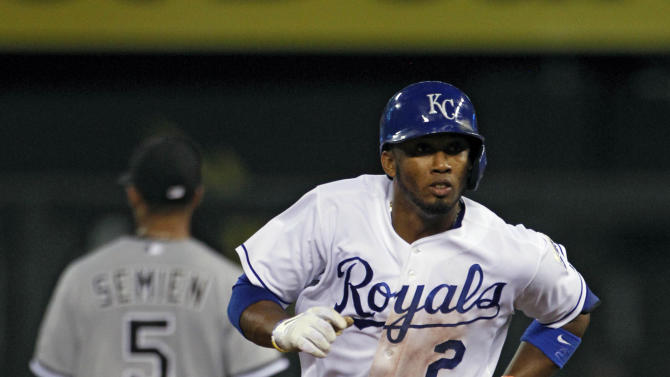 Kansas City Royals Alcides Escobar rounds the bases after hitting a home run in the fourth inning of a baseball game against the Chicago White Sox at Kauffman Stadium in Kansas City, Mo., Wednesday, Sept. 17, 2014. (AP Photo/Colin E. Braley)