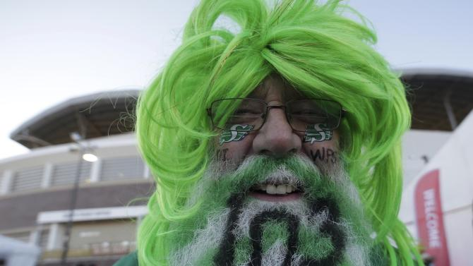 A Saskatchewan Roughriders fan celebrates the103rd CFL Grey Cup championship before the football game between the Ottawa Redblacks and the Edmonton Eskimos in Winnipeg