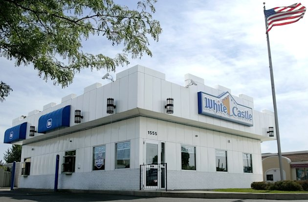 FILE - This June 21, 2004 file photo shows a White Castle restaurant in Columbus, Ohio. White Castle, the 90-year-old hamburger chain known for its square &quot;slider&quot; burgers, is considering the idea of offering alcoholic beverages. (AP Photo/Jay LaPrete, File)