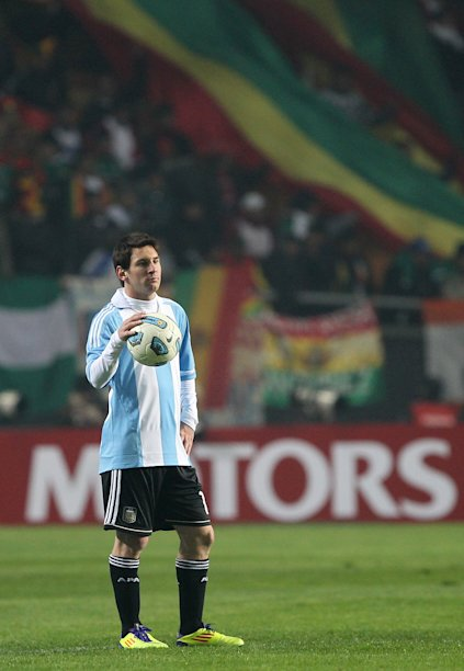 Argentine forward Lionel Messi is seen, with a Bolivian flag in the backgrounds, during a 2011 Copa America Group A first round football match held at the Ciudad de La Plata stadium in La Plata, 59 Km south of Buenos Aires, on July 1, 2011. AFP PHOTO / Maximiliano Failla (Photo credit should read Maximiliano Failla/AFP/Getty Images)