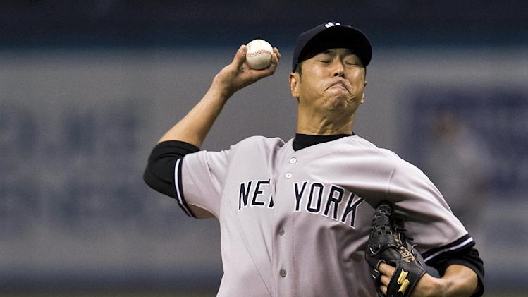 New York Yankees starter Hiroki Kuroda pitches against the Tampa Bay Rays during the first inning of a baseball game Friday, April 18, 2014, in St. Petersburg, Fla. (AP Photo/Steve Nesius)