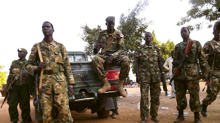South Sudanese soldiers gather near a truck as they patrol the streets of Juba on January 2, 2014
