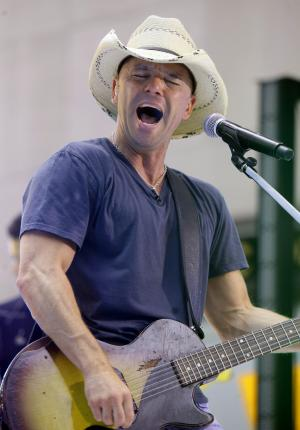 "FILE - In this June 17, 2011 file photo, singer Kenny Chesney performs on the NBC ""Today"" television program in New York. Chesney is up for nine Academy of Country Music Awards on Sunday, April 1, 2012. (AP Photo/Richard Drew, File)"