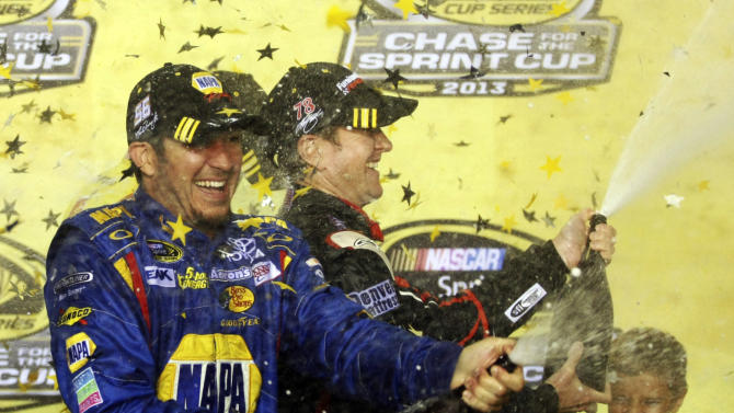 NASCAR Chase drivers Martin Truex Jr., left, and Kurt Busch, right, celebrate their making the Chase after the NASCAR Sprint Cup Series auto race at Richmond International Raceway in Richmond, Va., early Sunday, Sept. 8, 2013. (AP Photo/Jason Hirschfeld)