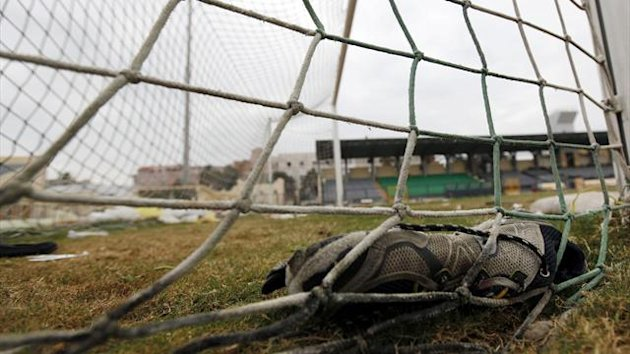 A shoe is seen inside the goal net one day after soccer supporters clashed at the Port Said stadium. Seventy-four people were killed when supporters clashed at an Egyptian soccer match (Reuters)