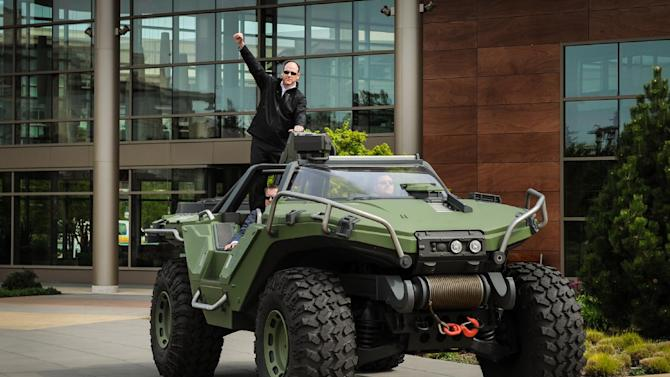 IMAGE DISTRIBUTED FOR PIZZA HUT - Pizza Hut Chief Marketing Officer Kurt Kane arrives aboard the UNSC Warthog from Halo to announce the new Pizza Hut for Xbox LIVE ordering app at the Microsoft campus, Tuesday, April 23, 2013 in Redmond, WA. (Rod Mar/AP Images for Pizza Hut)