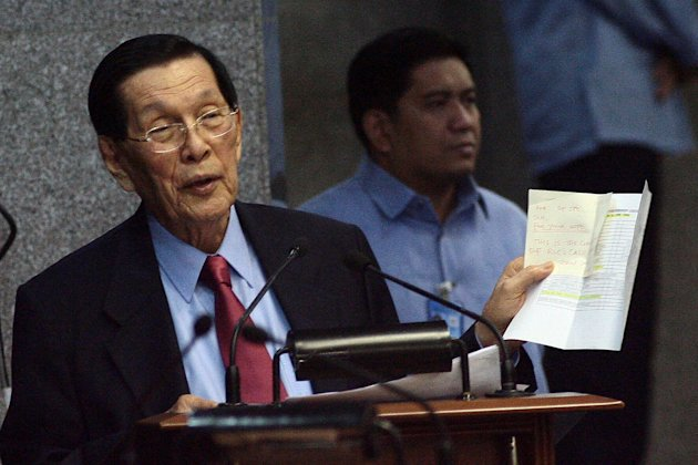 Senate President Juan Ponce Enrile answers the queries of Senator Allan Peter Cayetano during a session at the Senate, Jan. 23, 2013. (Voltaire Domingo, NPPA Images)