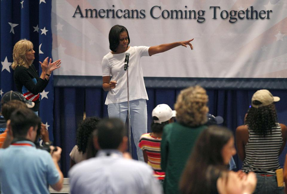 First lady Michelle Obama, accompanied by Vice President Joe Biden's wife Jill Biden, left, speaks to volunteers at a USO service project during the Democratic National Convention in Charlotte, N.C., Thursday, Sept. 6, 2012. (AP Photo/Chuck Burton)