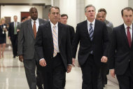 House Speaker Boehner of Ohio, center, left, and House Majority Whip Kevin McCarthy of Calif., center, right, walk through the Capitol in Washington, Tuesday, July 19, 2011, following a GOP caucus meeting. (AP Photo/J. Scott Applewhite)